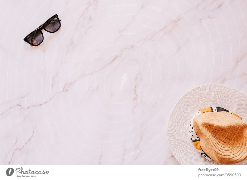 Flat lay of objects related to summer, spring and leisure against a marble background sunglasses hat flat lay flatlay copy space copyspace still still life