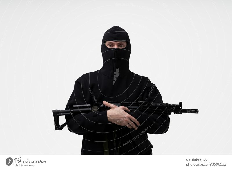 police special forces officer in black uniform isolated on white armed armor background bandit body counter enforcement equipment firearms gun law male mask