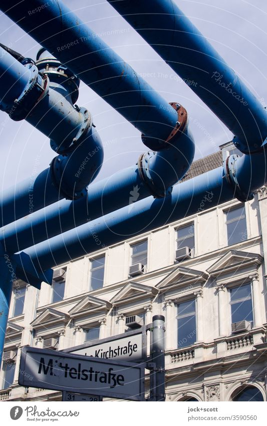 blue tubes across the Mittelstraße Facade Window Air conditioning Architecture Conduit Iron-pipe Symmetry Ravages of time conduit Construction Weathered