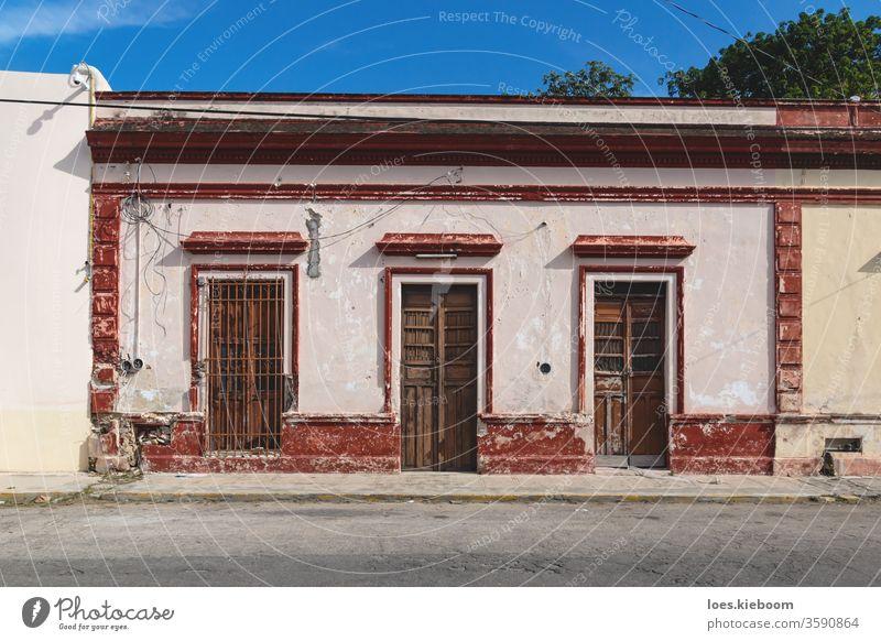 Facade of typical Mexican colonial building with wooden doors in Merida, Yucatan, Mexico mexico facade tourism yucatan merida street mexican colorful