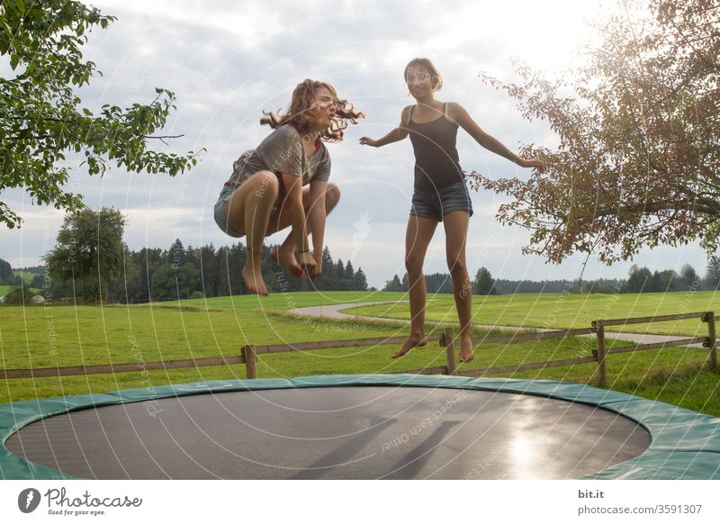 Don't be a frog... children girl teenager Youth (Young adults) Jump jump Jumping power Hop Trampoline Frog Funny wittily Playing Sports Athletic Joy Movement