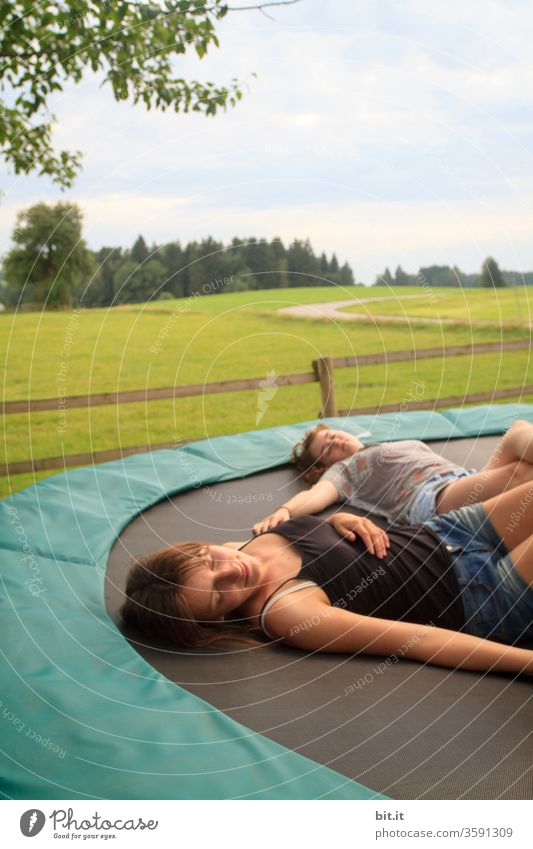 relaxation children girl teenager Youth (Young adults) Lie Sleep rest relaxing Break take a break Rest Goof off chilly Trampoline Dream Daydream Fatigue tired