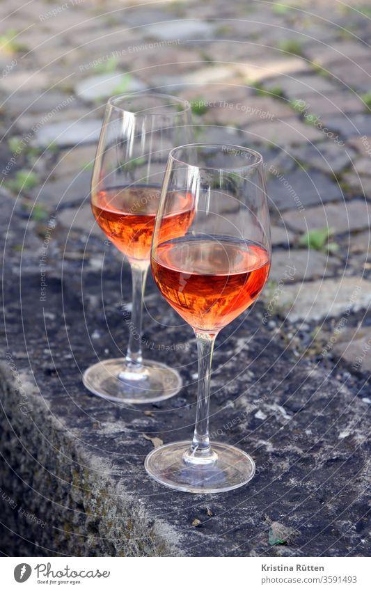two glasses rosé pink Rose Vine wine glasses Wine glass Glass Glazier Beverage Drinking Aperitif pinkado rosato out Garden Park Picnic aperitif drink drinks
