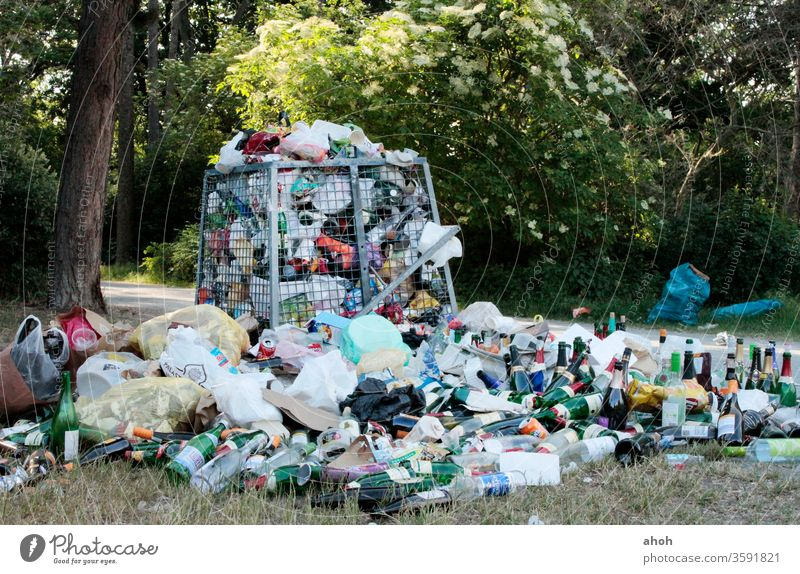 Garbage mountain in the park Trash mountain of rubbish waste Green spaces Waste management Indifference waste disposal public space waste separation Shackled