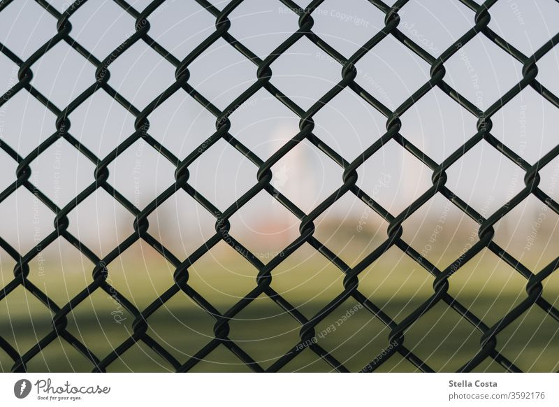 Meshed wire fence at Tempelhofer Feld Wire netting Wire netting fence texture textured background background blur Screensaver Fenced in Exterior shot Safety
