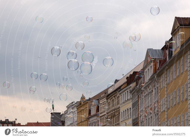 inflated| bubbles Town Downtown Old town Building Housefront Facade Historic Architecture Sky soap bubbles Many Inflated Hover variegated Dazzling big and small