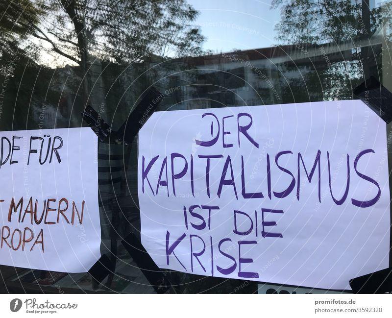 "Window display: ""Capitalism is the crisis"". Photo: Alexander Hauk neoliberalism protest Democracy Freedom of expression reflection daylight Exterior shot corona"