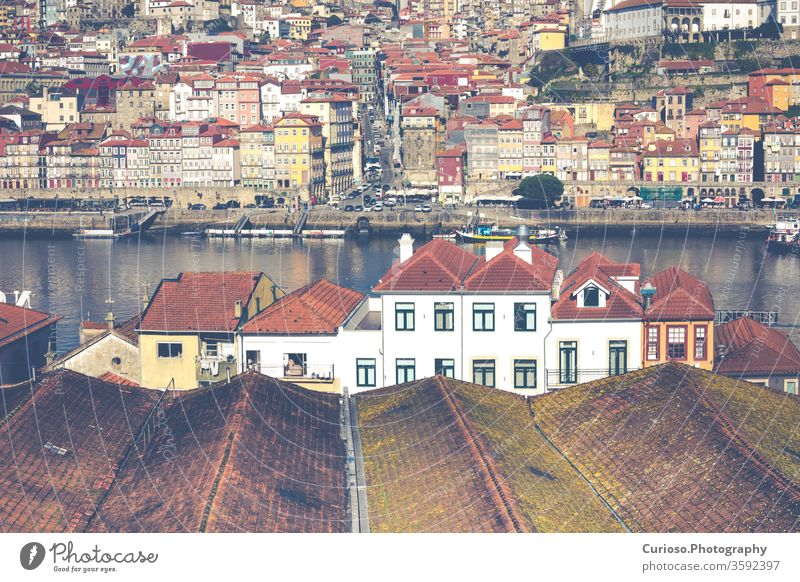 Douro river and Ribeira from roofs at Vila Nova de Gaia, Porto, Portugal. porto portugal view city old town douro architecture bridge travel historic portuguese