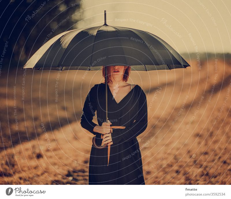 Woman with umbrella Umbrella Protection Umbrellas & Shades Sun Weather Hide