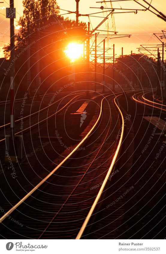 Sunset turning rail track into golden path dusk evening light line melancholy railroad railway speed steel sunset traffic train transport travel urban
