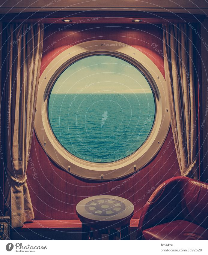 Porthole on the ferry Ferry Lake seafaring vacation Cruise cabin voyage ocean Land in sight