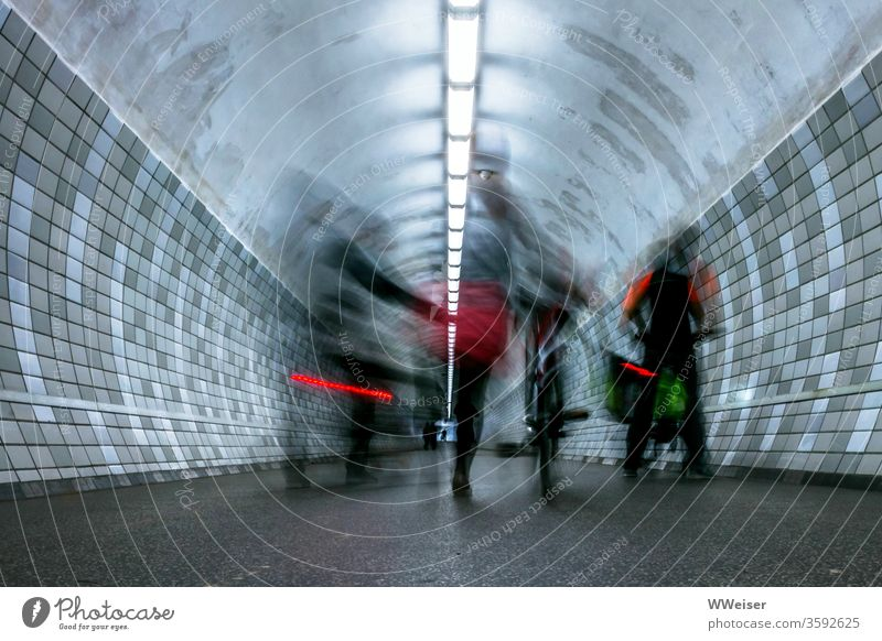 long time exposure, cyclist in pedestrian tunnel cyclists Tunnel reeds descend Push Rear light Long exposure Lighting tiles Transport Movement Hazy Blur Bicycle