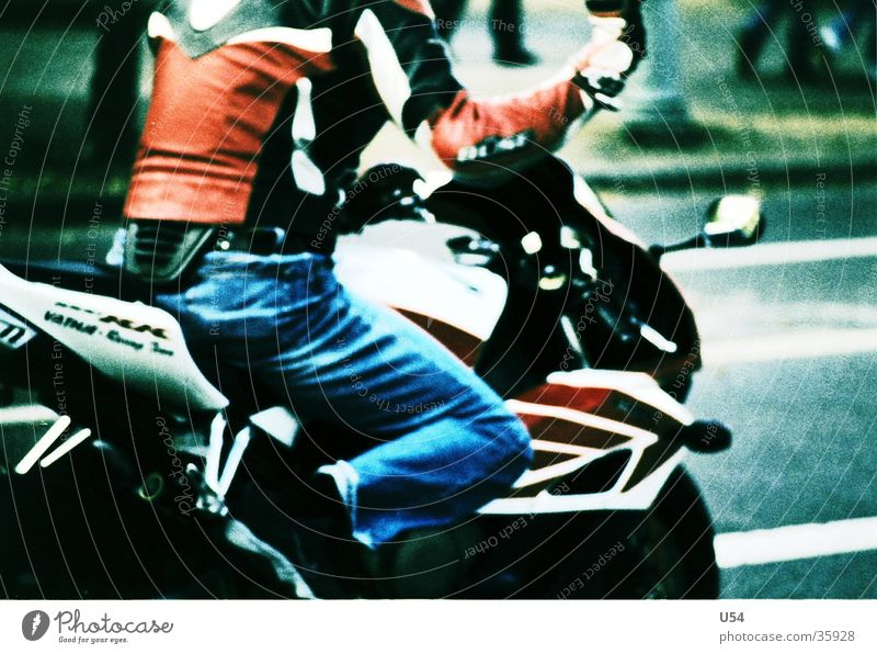 Corner of the eye. Motorcycle Speed Air Transport Street Lawn Movement Freedom