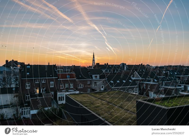 Sunset in Maastricht, Netherlands Europe Apartment Architecture reverence background already Blue built Comforting Church City cloud colourful Discover