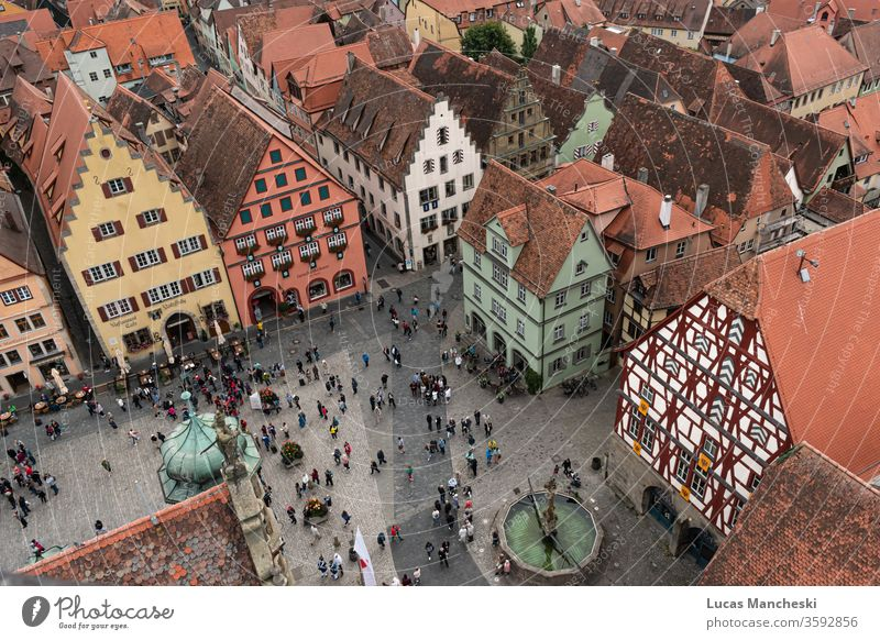 Looking down onto the square of Rothenburg, Germany during a local medieval festival aerial architecture building buildings city cityscape citysquare colors