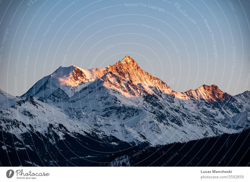 Swiss alps at golden hour sunset during the cold winters of Crans Montana, Switzerland alpine awe breathtaking clouds fiery freezing geological formation