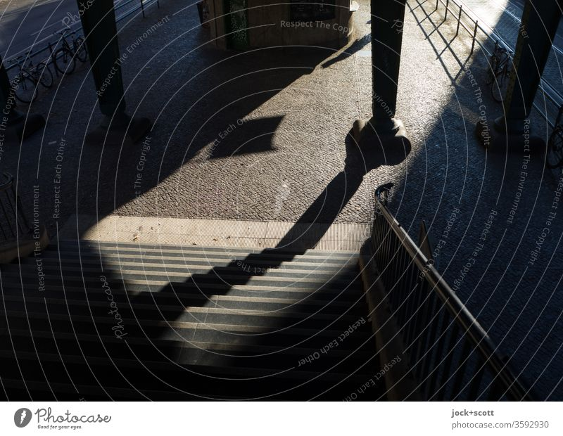 Rise for the big exit Wide angle Stairs Low-key Silhouette Sunlight Shadow Structures and shapes Abstract Shadow play Time Moody Emotions Lanes & trails