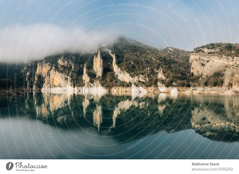 Calm lake among foggy rocky mountains landscape cold nature reflection rough range spain montsec magnificent calm water surface mirror tranquil scenic