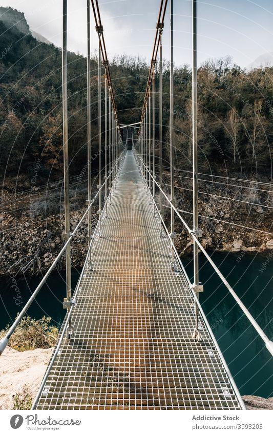 Suspension bridge in mountain gorge suspension rock pedestrian hang range river rough nature landscape breathtaking montsec empty way travel tourism journey