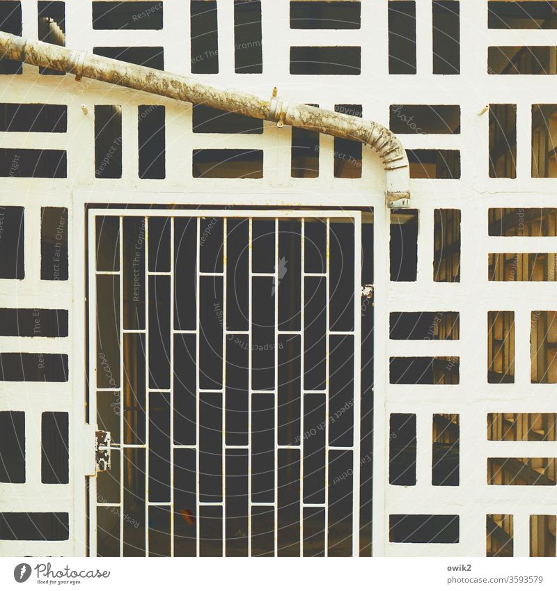 It creates order Goal door Exceptional Exterior shot Metal Bizarre Retro Old obliquely Rust Structures and shapes Detail Close-up Subdued colour Grating