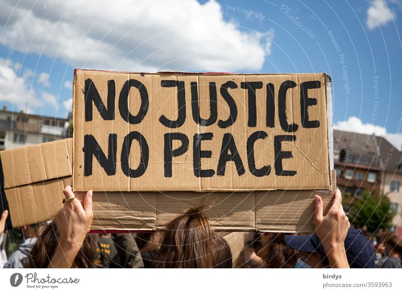 No justice - no peace. No justice - no peace. Cardboard sign with inscription on black lives matter - demonstration against racism and police violence