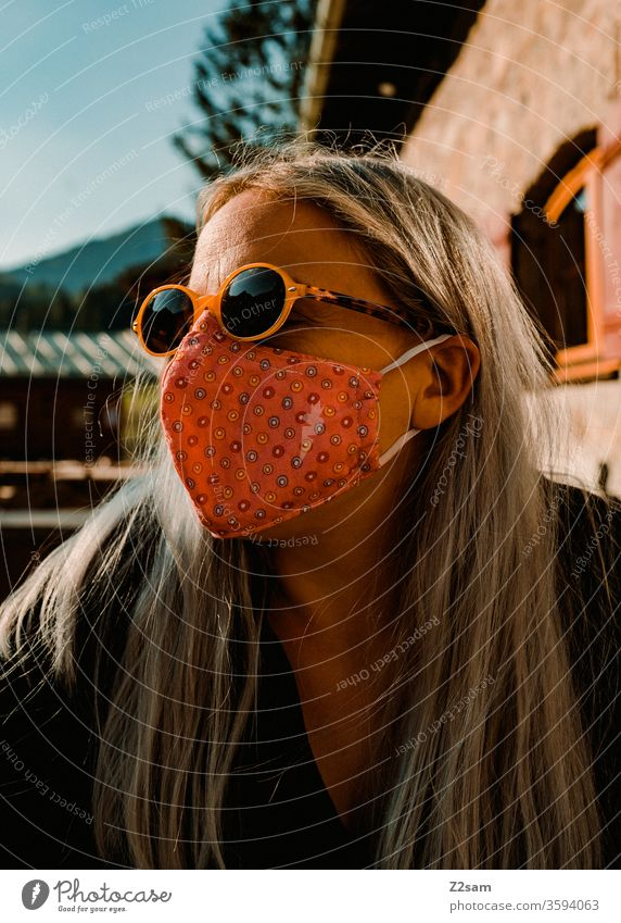 Woman with Corona mask in the beer garden Mask corona Virus Beer garden Bavaria Protection Sunglasses Healthy Infection Social life public portrait Blonde
