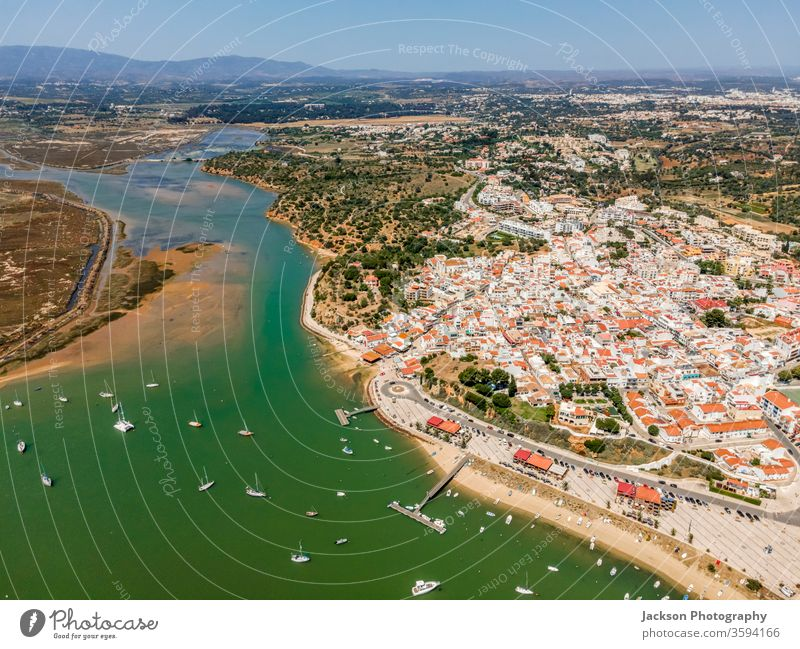 Aerial view of nature and city of Alvor, Algarve, Portugal alvor algarve portugal seaside seascape bay aerial landscape aerial view marina alvor portugal