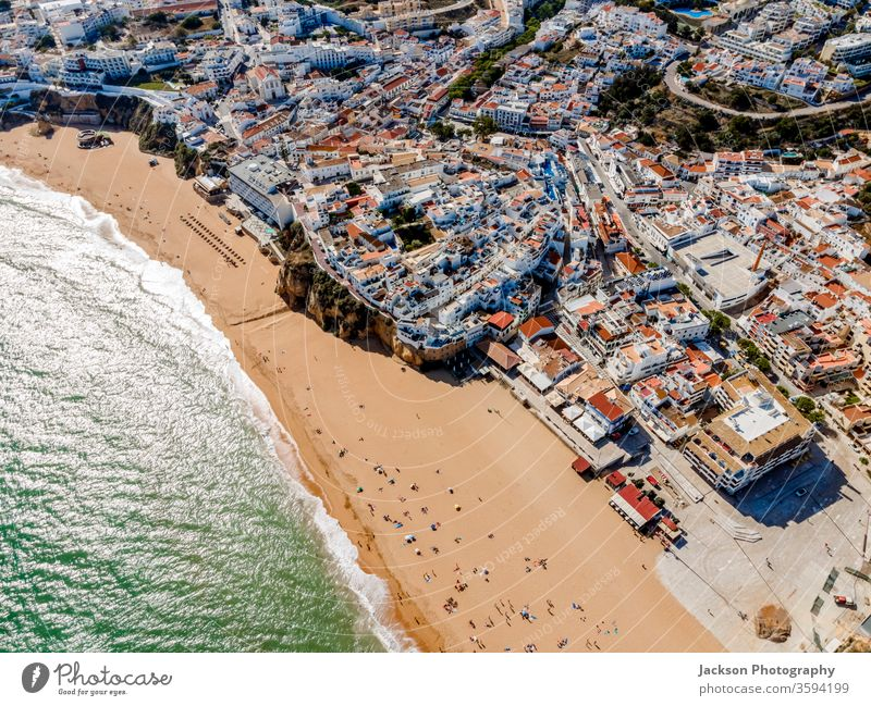 Aerial view of seaside Albufeira in Algarve, Portugal. architecture portugal albufeira beach aerial ocean white city town pier nature outdoor building