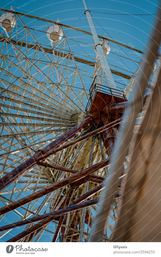 Portrait of a view from below of the Skyranch amusement park's Ferris wheel pleasure Attraction background Bavaria Blue Carnival Carousel celebration chill