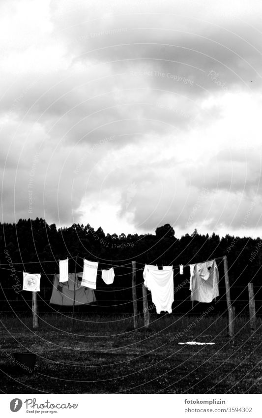 black and white clothesline outside with cloudy sky Clothesline Washing day Laundry Dry Living or residing Clean Household Hang up Clothing