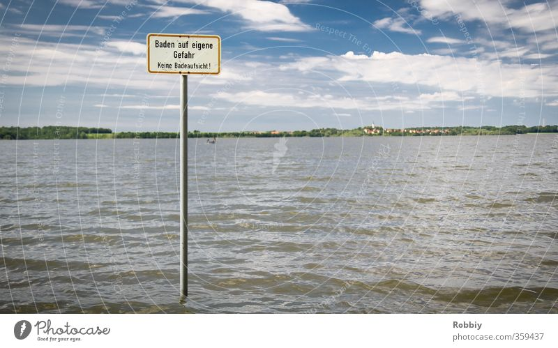 Bathing at your own risk Swimming & Bathing Beach Ocean Waves Aquatics Nature Landscape Water Coast Lakeside Pond Signs and labeling Signage Warning sign Blue