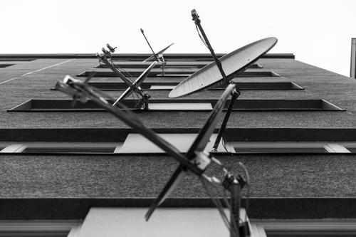 I glootz TV Satellite dish Prefab construction Wedding Berlin House (Residential Structure) Window Facade Architecture Balcony Gloomy Deserted Town