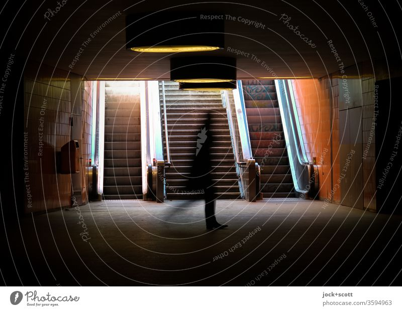 a gait in the underground past the light motion blur Silhouette Shadow Underpass Subsoil Going Lanes & trails Tunnel Passage Back-light Symmetry Mobility