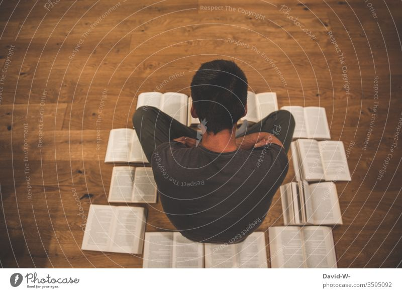 Man sits on the floor surrounded by books Book Reading Education formed Study Parquet floor wooden floor Page Academic studies School Colour photo Wisdom
