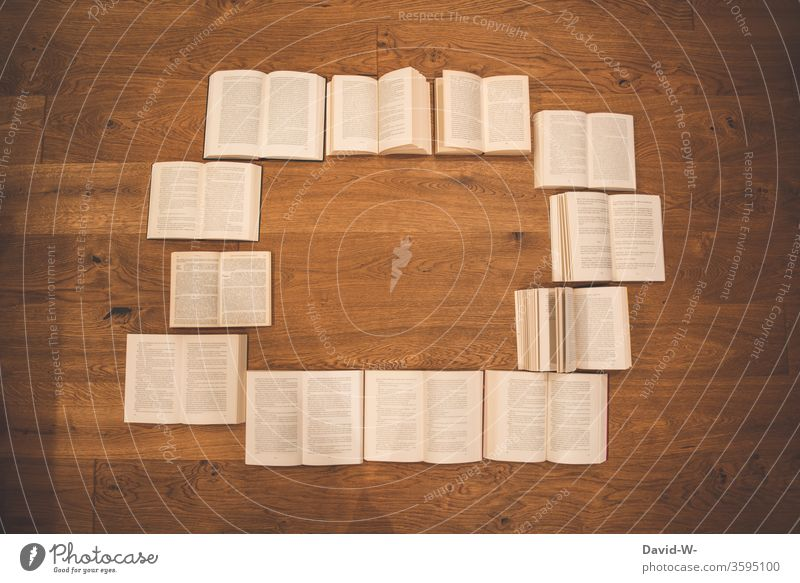 many opened books from the bird's eye view with text space in the middle book circle Book Reading Education formed Study Parquet floor wooden floor Page