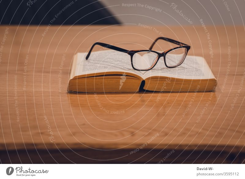 Reading glasses are on the book on a table Old books defective copy Book Education formed Study Parquet floor wooden floor Page Academic studies School