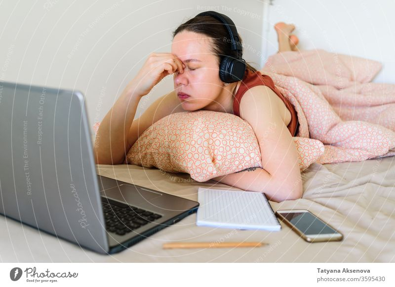 Woman working from home in her bed. Tired and stress woman computer laptop female learning tired bedroom business businesswoman person indoors professional