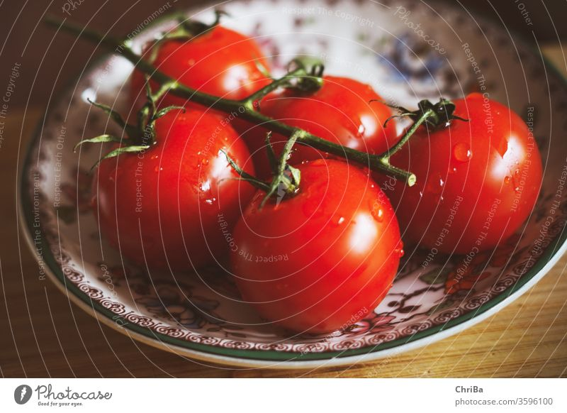 Fresh panicles of tomatoes on a colourful plate To enjoy Delicious Healthy Eating Vegetarian diet Close-up Colour photo Food fruit food and drink Nutrition