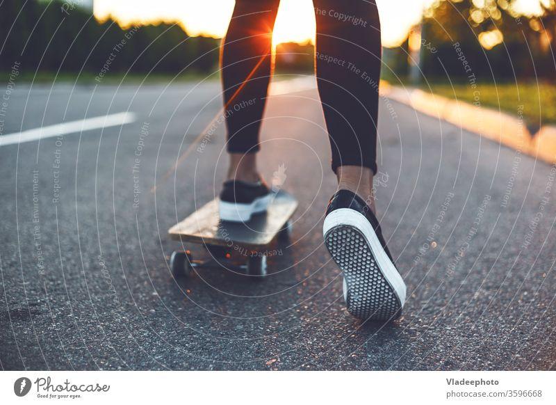 young skateboarder legs riding on skateboard girl shoes sneakers one woman female extreme youth yellow sunshine sports skateboarding usa vintage japanese