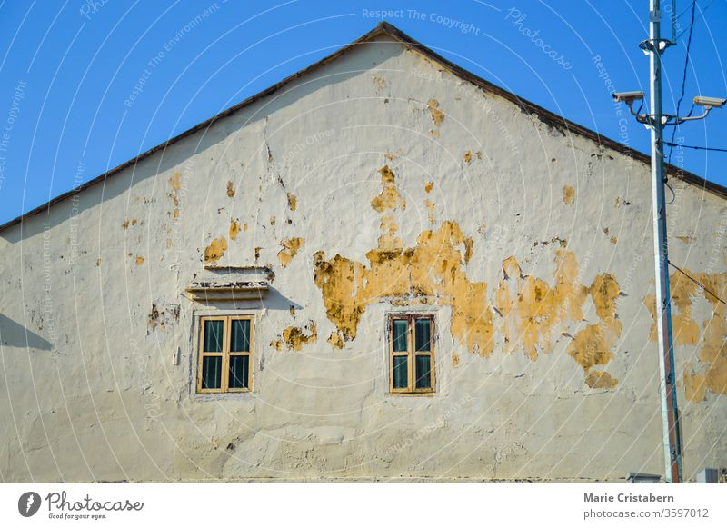 Windows on an old house with peeling off paint in the heritage town of Penang, Malaysia colonial old town exterior culture home peeling paint tourism