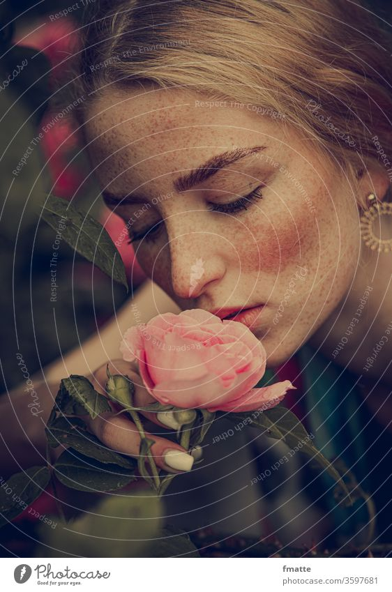 Young woman smells a rose Woman flowers Summer bleed Joy Fragrance Beauty & Beauty Beauty in nature Freckles Plant already natural Blossom leave Floral Pink