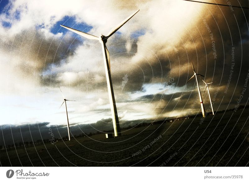 in the morning Electricity Wind energy plant Clouds Sunrise Energy industry Sky Power