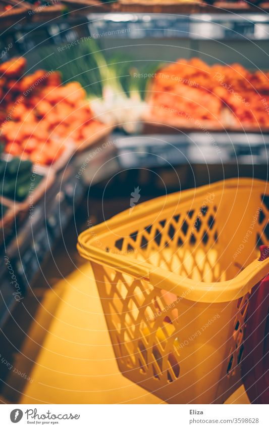 Shopping basket in the vegetable department in the supermarket Supermarket Shopping Trolley Food Vegetable fruit Department Consumption Retail sector Yellow