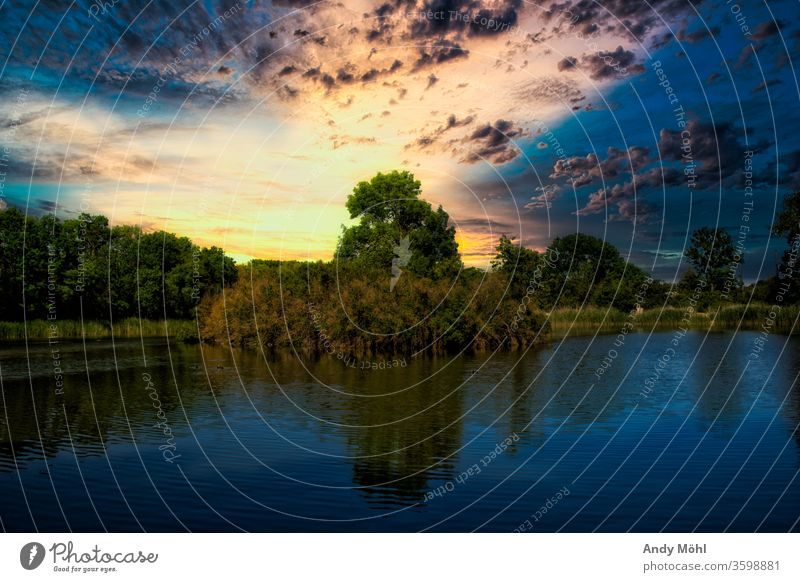 Evening walk by the lake Lake Water Sunset Colour huts Reflection Clouds Landscape Colour photo Deserted Calm Nature Summer Idyll Exterior shot Saxony-Anhalt
