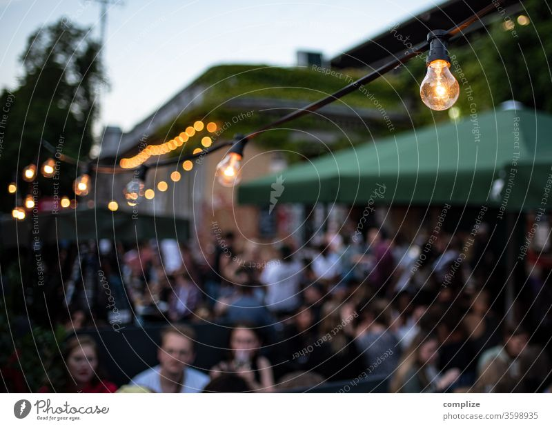 Urban beer garden Twilight Electric bulb Fairy lights Beer garden Idyll Terrace Lamp Exterior shot Wall (barrier) Outskirts Town Gastronomy Drinking Flirt