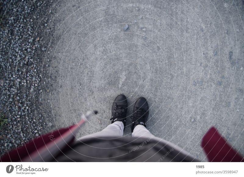 Exploring your own feet on a walk :) Gravel Footwear Black Gray bordaux Dark gray foot Legs Jacket Woman Exterior shot feminine Stand Gravel road