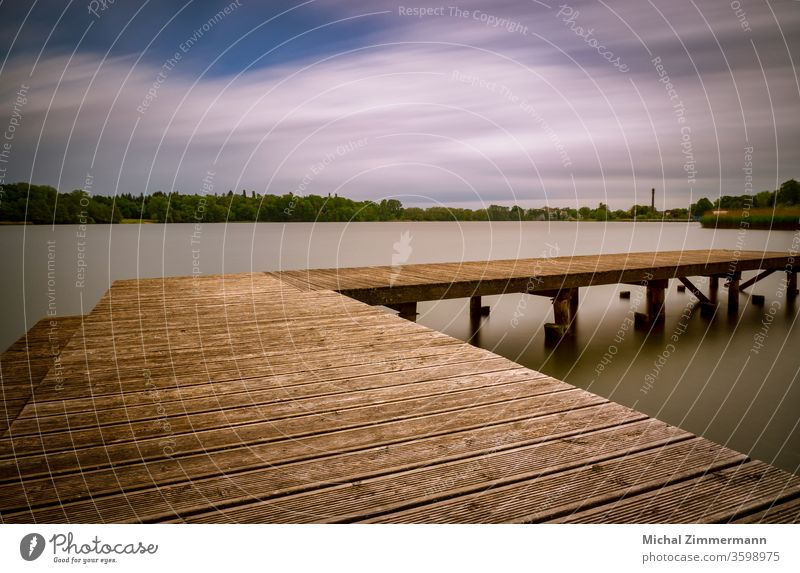 jetty at a lake Footbridge Lake Lakeside Water Surface of water Green Wood Nature Love of nature Experiencing nature Spring Exterior shot Deserted Landscape