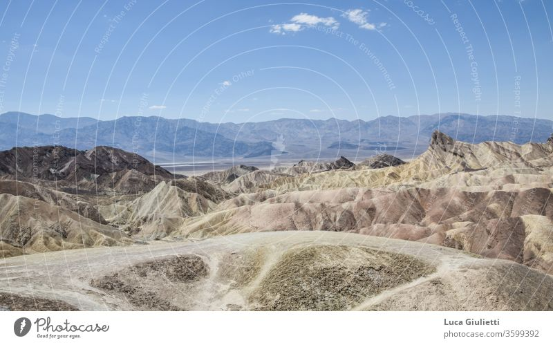 Zabriskie Point on the Death Valley Sand Dune Art outdoors Landscape Landscape format Landing colorful Color gradient Deserted Fossil arid Sandstone Sky aridity