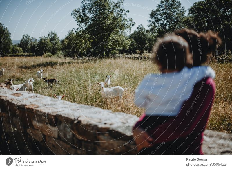 Mother and Daughter watching goats motherhood Together togetherness Goats Travel photography travel Traveling Happiness people Family & Relations Lifestyle Love