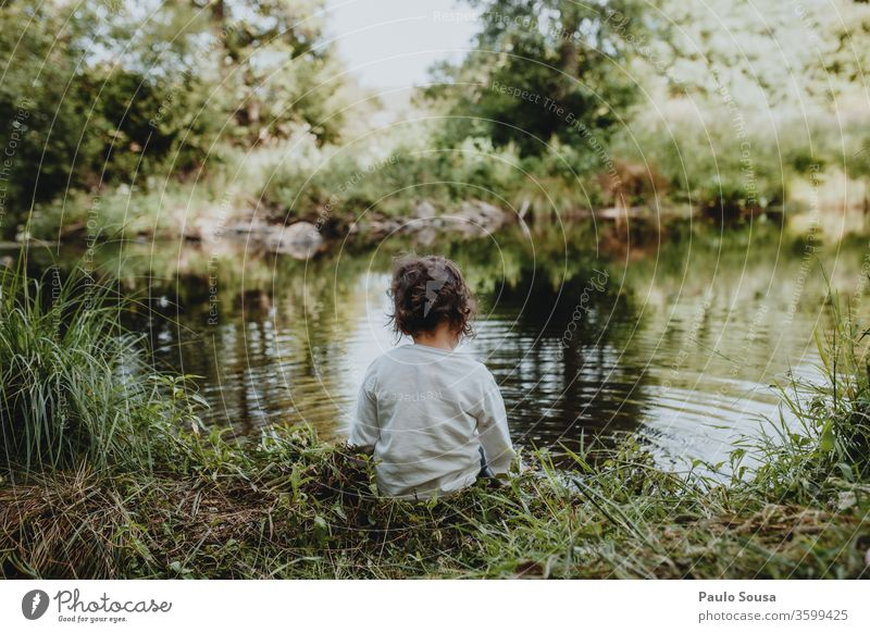 Little girl sitting by the river Child Rear view back view Caucasian 1 - 3 years River Human being Colour photo Infancy Exterior shot 3 - 8 years Toddler Day